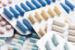 image contenant différents types de comprimées et gellules